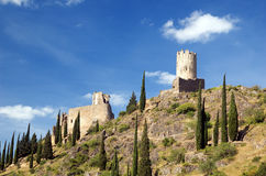 Castillo de Lastours 2. Regina and Sourdespine towers of Lastours Castle at the top of the ridge from the access pathway on a sunny day Stock Photos