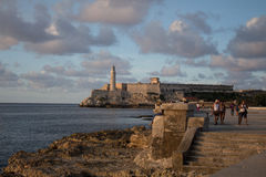 Castillo de los tre reyes del morro (Cuba). Some fishermen are going back home from the castillo de los tre reyes del morro (Cuba Royalty Free Stock Photo