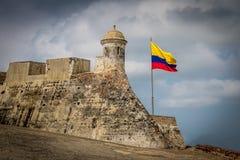 Castillo De San Felipe i kolumbijska flaga - Cartagena, Kolumbia Fotografia Stock