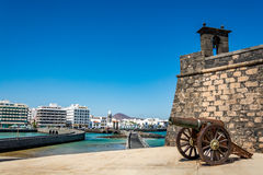 Castillo de San Gabriel - Saint Gabriel Castle in Arrecife and a cannon in front of it royalty free stock image