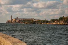 The Castillo Del Morro lighthouse in Havana. View from Malecon waterfront. The old fortress Cuba. The Castillo Del Morro lighthouse in Havana. The old fortress Royalty Free Stock Photos
