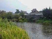 Castillo por el lago imagen de archivo