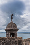 Castillo San Felipe del Morro tower with pelican. On top. Angry stormy sky  in San Juan Puerto Rico Royalty Free Stock Photos