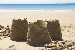 Castillos de arena y playa Imágenes de archivo libres de regalías