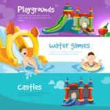 Castillos inflables y las colinas de los niños en patio Imágenes de archivo libres de regalías