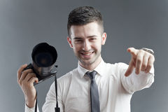 Casting call. Friendly photographer with photo camera in his hand pointing at you, announcing a casting call royalty free stock photos