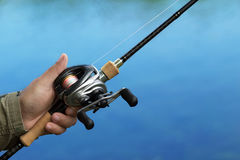 Casting a fishing reel and spinning Stock Photos