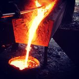 Casting. Live Pic of pouring metal in casting industry royalty free stock photo