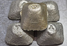 Casting of metal in the shape of a tetrahedron. Metallurgy Stock Photography