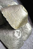 Casting of metal in the shape of a tetrahedron. Metallurgy Royalty Free Stock Photo