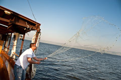Casting nets on the Sea of Galilee Stock Photos