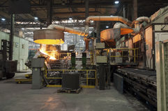 Casting in Steel Mill. Steel Mill in Action : iron casting royalty free stock images