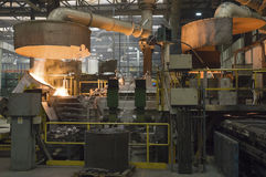 Casting in Steel Mill Stock Photo