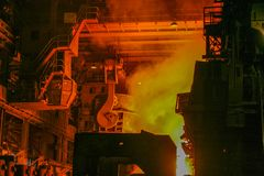 Casting of steel in the open-hearth furnace stock photography