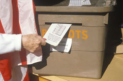 Casting vote at ballot box Stock Image