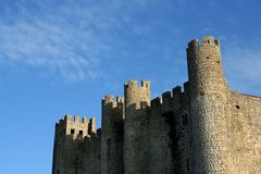 Castle. Wall in blue sky stock images