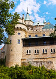 Castle. Middle Ages castle surrounded with green and deep blue sky royalty free stock photos