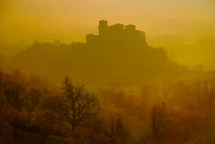 Castle. Of Torrechiara al the sunsrise with fog stock photo