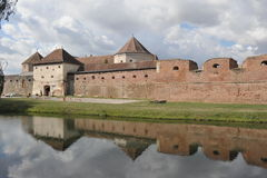 Castle. Fagaras Fortress, reflected in the water Royalty Free Stock Photo