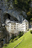 Castle. More than 700 years old castle in a rocky cliff over 100 metres high: powerful and defiant – an impregnable fortress. Today's castle dates from the Stock Image