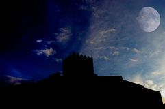 Castle. An ancient portuguese castle and the moon Royalty Free Stock Image