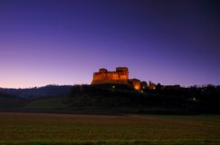 Castle 3. The Torrechiara's Castle (Italy) in the sunset stock images