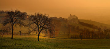 Castle. Of Torrechiara al the sunsrise with fog stock photography