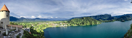Castle above the lake. Beautiful views of the Alps from Lake Bled Stock Photography