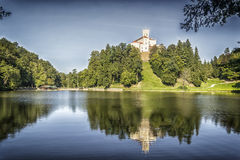 Castle above the lake. Beautiful coherence of nature and historical architecture ... It works very smooth and romantic, hearty corner where a man rested soul and Stock Photo