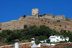 Castle above town, Jimena de la Frontera, Spain. View of the castle above the village rooftops, Jimena de la Frontera, Cadiz Province, Andalusia, Spain, Western Royalty Free Stock Image
