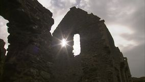 A castle in the afternoon. A steady tilt up shot of a ruined castle in Ireland stock video