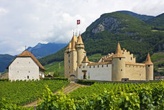 Castle Aigle, Switzerland. Chateau d'Aigle panorama, Switzerland, with vineyards and mountains Royalty Free Stock Image
