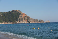 Castle of Alanya built on rocks and beach of Cleopatra Royalty Free Stock Images
