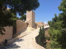 Castle Alicante Spain. Stone watch tower overlooking road into castle Stock Photos