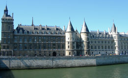 Castle alongside Seine in Paris Stock Images