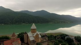 Ancient Ananuri fortress located near the peaceful mountain lake in Georgia, topshot stock video