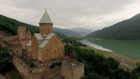 Aerial view of a Castle ananuri Georgia against a backdrop of picturesque mountains and a river stock video