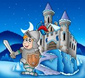 Castle And Knight In Winter Landscape Stock Image