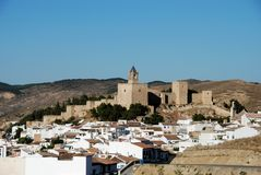 Castle, Antequera, Andalusia, Spain. Castle fortress with townhouses in the foreground, Antequera, Malaga Province, Andalusia, Spain, Western Europe Royalty Free Stock Image