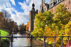 Castle in autumn scenery. Neo Gothic castle in Heverlee Antwerp, Belgium - autumn scenery Royalty Free Stock Photo