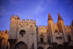 The castle of Avignon. The pope's palace in the sunset light of the town of the city of France Royalty Free Stock Photos