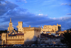 The castle of Avignon. The pope's palace in the sunset light of the town of the city of France Stock Photos