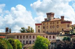 The castle of Barolo Piedmont, Italy. Panorama of Barolo Piedmont, Italy with the town and the medieval castle. Barolo is the main village of the Langhe wine stock images