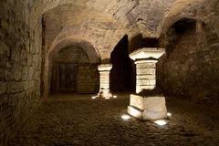 Creepy castle basement. Fantasy and creepy basement of a castle with arched columns Stock Photos