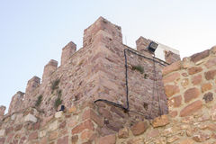 Castle with battlements and walls of red stones, Villafamés rur Stock Images