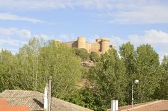 Castle of Belmonte. Sight of the castle from street of Belmonte village, province of Cuenca, Spain Royalty Free Stock Photo