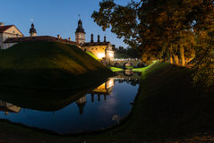 Castle in the Belorussian town of Nesvizh with night reflection in moat water Stock Images
