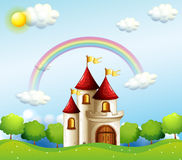 A castle below the rainbow Stock Photos