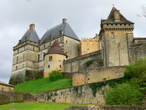 Castle, Biron (France ). Western view of the castle of Biron in spring Royalty Free Stock Photo