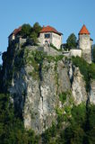 Castle of Bled. Lake of Bled with castle and ancient dock in north of Slovenia Stock Photography